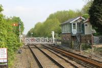 The line towards Sleaford, as seen from the south end of the rebuilt platforms at Metheringham station. Blankney signalbox can be seen protecting the level crossing, its name dating from when the station was known as Blankney and Metheringham.<br><br>[Mark Bartlett&nbsp;21/05/2012]