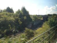 View of the goods line that starts at Cadoxton Station and runs parallel to the passenger line almost to Barry Docks station where it drops down and turns under Ffordd Y Mileniwm to reach the Barry Docks' industrial complex. <br><br>[David Pesterfield&nbsp;19/09/2012]
