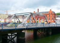 One of the Scherzer rolling lift bridges over a channel of the River Lee in Cork [see image 40504]. This was 'fixed' in the 1980s after the rail traffic ceased and the overhead control cabin, counterweight and mechanism were removed.<br><br>[Colin Miller&nbsp;22/05/2008]