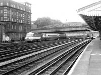 A BR InterCity 125 Bristol - Paddington service approaching its destination in 1982, seen from the platform of Royal Oak Metropolitan Line station. In the background one of the Western Region Express Parcels units is waiting for the road into Paddington parcels depot. [See image 36915] <br><br>[John Furnevel&nbsp;22/01/1982]