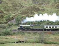 Neither K1 No. 62005 running as LNER No. 2005 in apple green nor the rake of Mk 1 coaches in the LNER tourist livery was strictly authentic in appearance, but they did at least make a harmonious ensemble. Here the westbound <I>'Lochaber'</I> is on the climb away from Glenfinnan on 2 June 1988, shortly before breasting the summit and starting the descent towards the south shore of Loch Eilt.<br><br>[Bill Jamieson&nbsp;02/06/1988]