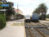 Scene at Hyeres, just to the east of Toulon, standing at the end of a 10km single line branch from the main Marseille to Nice line. The train on the left is the 10:11 TGV to Paris, due to arrive in Paris at 14:56.  Not bad for a journey in excess of 850km. On the right is the 10:31 stopper to Marseille via Toulon consisting of a pair of 2-car double deck units. <br><br>[Malcolm Chattwood&nbsp;29/09/2012]