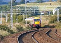 Looking west from Ardmore East level crossing on 22 September 2012 as 334016 heads towards Craigendoran and ultimately Helensburgh Central.<br><br>[John McIntyre&nbsp;22/09/2012]