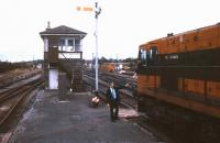 Token exchange alongside Claremorris signal box in July 1988.<br><br>[Ian Dinmore&nbsp;/07/1988]