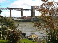 A class 170 heads into Fife over the Forth Bridge, seen from the approach road to North Queensferry (Old) station, on 3 October 2012.<br><br>[Bill Roberton&nbsp;03/10/2012]
