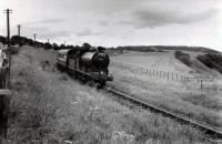 64615 heading south past North Water Bridge Halt with the 1960 RCTS/SLS Joint Scottish Tour. The train is about to cross the North Water Bridge Viaduct.<br><br>[WA Camwell (Copyright Stephenson Locomotive Society)&nbsp;16/06/1960]