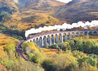Black 5 No. 45407 leaves an attractive smoke trail as it crosses Glenfinnan Viaduct on 10 October 2012 with <I>The Jacobite</I> steam service to Mallaig.<br><br>[John Gray&nbsp;10/10/2012]