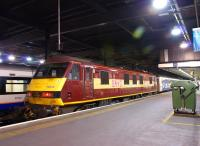 Having brought the ecs for the Highland Sleeper into platform 15 at Euston, 90028 now waits for the train to depart before going onto the front of the Lowland Sleeper.<br><br>[John McIntyre&nbsp;10/10/2012]