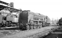 Rebuilt Bulleid <I>West Country</I> Pacific no 34025 <i>Whimple</i> stands in the shed yard at 70A Nine Elms in the 1960s. The locomotive was eventually withdrawn from Bournemouth shed in July 1967.<br><br>[K A Gray&nbsp;//]