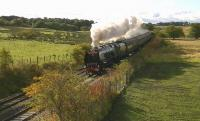 Ex-LMS Pacific no 46233 'Duchess of Sutherland' with the PMR Tours <I>Caledonian</I>, roars past Magiscroft near Cumbernauld on 6 October on its way to Stirling.<br><br>[Ken Browne&nbsp;06/10/2012]