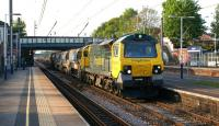 Freightliner 70016 runs south through Leyland on 21 May 2012 heading for Crewe Basford Hall yard with a Network Rail engineers train of auto-ballasters and ballast wagons. <br><br>[John McIntyre&nbsp;21/05/2012]