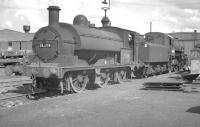 Aspinall ex-LYR Class 23 0-6-0ST no 11324 with Ivatt 4MT 4-6-0 no 43063 in the yard at Horwich Works in June 1963. The former was one of a number of the class retained for use as departmental locomotives within the works.<br><br>[K A Gray&nbsp;22/06/1963]