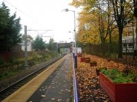 Autumn leaves at Crookston on 22 October 2012. View is east towards Glasgow Central, with overhead equipment now in place as part of the electrification of the Paisley Canal branch.<br><br>[John Yellowlees 22/10/2012]