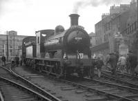 Saturday 29 August 1964 was the day of the SLS/BLS J36 Railtour. The special, which was hauled throughout by 65234, visited selected branch lines in and around Edinburgh.  The train is seen here at North Leith with participants returning to their seats prior to departure on the next leg of the tour to Penicuik [see image 23124].<br><br>[K A Gray&nbsp;29/08/1964]