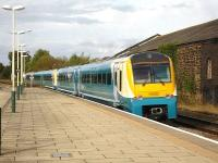 Arriva Trains 175002, extensively damaged in the 2011 Whitland level crossing crash, has now been repaired. The unit is seen here on 1 October bringing up the rear of the 16.02 service departing from Wrexham General bound for Chester <br><br>[David Pesterfield&nbsp;01/10/2012]