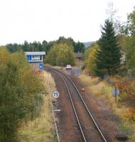 Looking north east towards Stanley Junction on 13 October 2012 with the line curving left towards Murthly. The former double track main line to Kinnaber Junction would have been where the signaller's car is parked in the middle of the picture. A house has been built on the trackbed beyond the car. [See image 7377]<br><br>[John McIntyre&nbsp;13/10/2012]