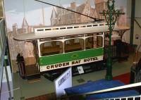 One of the two trams that linked the GNSR Cruden Bay Hotel and Cruden Bay station on display at the Grampian Transport Museum, Alford, in October 2012. Car No 2 is beautifully restored to a very high standard and is displayed in front of a large image of the hotel. Cruden Bay hotel closed in 1948 and was subsequently demolished.  <br><br>[John McIntyre&nbsp;16/10/2012]