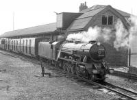 A train waits at the platform at Dungeness on the Romney, Hythe and Dymchurch Railway in 1967. The locomotive is Mountain class 4-8-2 No 5 <I>Hercules</I> [Davey Paxman 16041/1927]. This locomotive hauled the inaugural train from Hythe on the opening day of the line on 16 July 1927. <br><br>[Robin Barbour Collection (Courtesy Bruce McCartney)&nbsp;//1967]