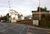 View east from the level crossing at Insch on 16 October 2012 with the signalbox and water tower standing guard on either side of the track. A station totem has appeared on the west side of the water tower.<br><br>[John McIntyre&nbsp;16/10/2012]