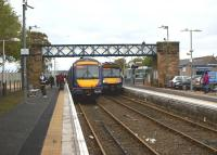 The crowds had been gathering on both platforms for over 30 minutes at Dyce in the afternoon of 19 October 2012. On the right the Inverurie to Edinburgh service is getting ready to depart, while on the left an Aberdeen to Inverness service is boarding. Off to the right were the former Buchan line platforms, now filled in and used as a car park. To the left of the station is Dyce Airport reached via a connecting bus service.<br> <br><br>[John McIntyre&nbsp;19/10/2012]