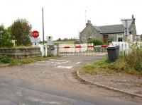 Scene at the site of Pitmedden station on the GNSR mainline from Aberdeen to Keith in October 2012 with no trace remaining of the station itself. Alongside the level crossing however is the stone base of the old signalbox. To the left the line heads for Kintore and to the right towards Dyce.<br><br>[John McIntyre&nbsp;19/10/2012]