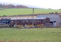 An old 9 compartment suburban coach has found further use on a farm near Torphins. Viewed from the B993 just south of the village on 19 October 2012. It would appear to have seen 'better days' and although missing quite a few bits and pieces has had two external lights fitted.<br><br>[John McIntyre&nbsp;19/10/2012]