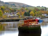 An MPV on <i>leaf train</i> duties heads east past Bowling Harbour. The view is from Frisky Wharf, the eastern extreme of the former Caledonian and Dumbartonshire Junction Railway. In the distant right a portion of viaduct on the closed Caledonian route can be seen. This harbour, built with money from the forfeited estates of the Jacobites, has for over a hundred years been the final resting place of vessels. It was also used for winter lay-over for part of the Clyde steamer fleet.<br><br>[Ewan Crawford&nbsp;27/10/2012]