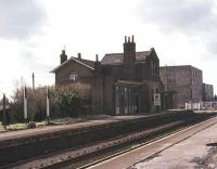 <I>'At Long Stanton I'll stand well clear of the doors no more.'</I> So goes the line in the evocative Flanders and Swann 1964 song 'Slow Train'. The closed station on the Cambridge - Huntingdon line is seen here in 1977. The route is now part of a guided busway [see image 35650]. [With thanks to Kenneth Leiper, David Prescott and Jim Petrie]. <br><br>[Ian Dinmore&nbsp;//1977]