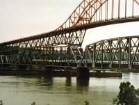 The 'Rocky Mountaineer' is a long train but still dwarfed by the bridges at New Westminster East of Vancouver, seen here in June 1998.<br><br>[John Thorn&nbsp;/06/1998]
