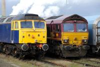 Locomotives 47843 and 66182 stabled in the station sidings at Didcot on 1 November.<br><br>[Peter Todd 01/11/2012]