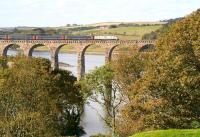The colours of Autumn dominate in this view west along the Tweed from Berwick on 9 October 2012. The train crossing the Royal Border Bridge is the East Coast 09.00 Kings Cross - Edinburgh, which is slowing for the Berwick stop.<br><br>[John Furnevel&nbsp;09/10/2012]