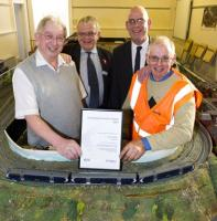 Irvine Station has been named Best Adopted Scottish Station 2012 by<br> Passenger Focus, the independent watchdog. [See previous news item] The photograph shows (L-R) Tom Rout of Kyle Model Railway Club; ScotRail's external relations manager, John Yellowlees; Robert Samson, passenger manager (Scotland) for Passenger Focus, and Louis Wall of South West Station Gardeners Group. <br><br>[ScotRail&nbsp;06/11/2012]