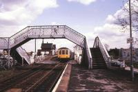 A Cleethorpes - Sheffield DMU about to run over the level crossing and into the up platform at Habrough, Lincolnshire, on the western outskirts of Immingham, in May 1986.<br><br>[Ian Dinmore&nbsp;/05/1986]