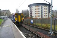 Scene at Paisley Canal on 7 November 2012, with a service to Glasgow Central ready to depart alongside one of the notices regarding the work currently underway on the electrification of the branch.<br><br>[John Yellowlees&nbsp;07/11/2012]