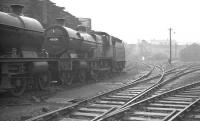 Monument Lane shed, Birmingham, looking west from the entrance to the shed yard, in November 1960. The line to Wolverhampton runs past off to the right, while to the left and behind the camera stands the large City Sawmill. Ex-LMS 40936, officially withdrawn from here in January 1961, is one of a pair of Compounds in the picture. The locomotive was cut up in September that year at nearby Cashmores, Great Bridge. The shed (closed 1962) and sawmill are long gone, with most of the area now occupied by the National Indoor Arena and car park.<br><br>[K A Gray&nbsp;26/11/1960]