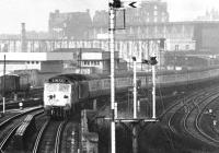 A murky Monday in May 1971 sees a pair of EE Class 50s lifting a mid-morning Glasgow Central - London Euston train out of Carlisle station. The train is about to cross the bridge over the goods lines. [See image 5345]<br><br>[John Furnevel&nbsp;24/05/1971]