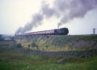 Train locomotive and banker both working hard climbing Shap in the 1960s.<br><br>[Robin Barbour Collection (Courtesy Bruce McCartney)&nbsp;//]