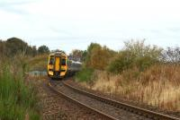 With the remains of Kintore station platform behind the photographer, an Inverness service disappears towards Inverurie on 19 October 2012. The line to Alford curved away to the left at this point and is still identifiable as such for a short distance.<br><br>[John McIntyre&nbsp;19/10/2012]
