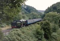 <I>Evening Star</I> cautiously descends the 1 in 49 from Goathland to Grosmont in July 1986. <br><br>[Colin Miller&nbsp;/07/1986]