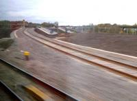 Open at last! A grab shot from a passing Turbostar, looking North along the Chord on 9 November. The yellow and red signals are normal aspects when one of the current two freight trains a day is not expected. The WCML can be seen on the right.<br><br>[Ken Strachan&nbsp;09/11/2012]