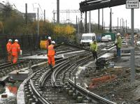 Installing a tram crossover at Haymarket Yards on 12 November. Looking west with the E & G main line running behind the shrubbery on the left. <br><br>[Bill Roberton&nbsp;12/11/2012]