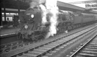 Rebuilt Bulleid 'West Country' Pacific no 34036 <I>Westward Ho!</I> with an up express waiting to leave Exeter St Davids on 5 October 1961.<br><br>[K A Gray&nbsp;05/10/1961]