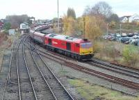 Having just run round its train of empties from Fiddlers Ferry at Latchford Sidings, DBS 60040 runs back through Arpley Junction but turns left for Arpley Yard.<br><br>[Mark Bartlett&nbsp;13/11/2012]