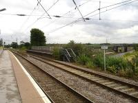 Looking north east along the high level platform at Lichfield in July 2012 with the shortened disused platform on the right. The signal box controlling the north to east spur stands in the left background.  The lower level West Coast main line can be seen centre right approaching from the Tamworth direction.<br><br>[David Pesterfield&nbsp;31/07/2012]