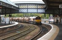 A DBS Class 66 takes the Dundee route at Perth station on 13 October 2012 with a rake of tank wagons.<br><br>[John McIntyre&nbsp;13/10/2012]