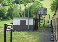 The water tank at Nantyronen on the Vale of Rheidol line, used to replenish locomotives on the very demanding rising gradient when working towards Devils Bridge from Aberystwyth, seen here from a train on 30 May 2012. <br><br>[David Pesterfield&nbsp;30/05/2012]