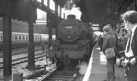 Platform scene at Manchester Victoria on 9 June 1968 with Black 5 no 45350 assisting with the stock of the BR (LMR) <I>'Midland Line Centenary Special Railtour'</I>. During a two hour stopover at Victoria a short DMU tour had been arranged for participants to Manchester Piccadilly and back. The special later left for Nottingham Midland behind 70013 'Oliver Cromwell' [see image 32850]. [With thanks to Vic Smith, John Robin and Douglas Corrigan]<br><br>[K A Gray&nbsp;09/06/1968]