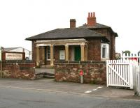 Entrance to the 1848 station at Leeming Bar with its unique Italianate pillared portico. The station was closed to passengers by BR in April 1954, but is now the headquarters of the Wensleydale Railway. View west over the old A1 road on 9 July 2012 with the level crossing on the right. <br><br>[John Furnevel&nbsp;09/07/2012]