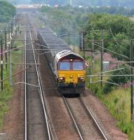 With heavy traffic on the M6 in the background, EWS 66076 approaches Gretna Junction from the south in August 2007 with coal empties. The train will take the G&SW route at the junction. <br><br>[John Furnevel&nbsp;03/08/2007]