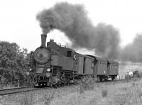 Any efficiency gains from the fitting of a Giesl ejector are not obvious as lightweight 2-8-2T No. 93.1322 makes a smoky start out of Schwarzenau along the single track line from Vienna with the 14.10 departure to Gm�nd in September 1975. <br><br>[Bill Jamieson&nbsp;09/09/1975]